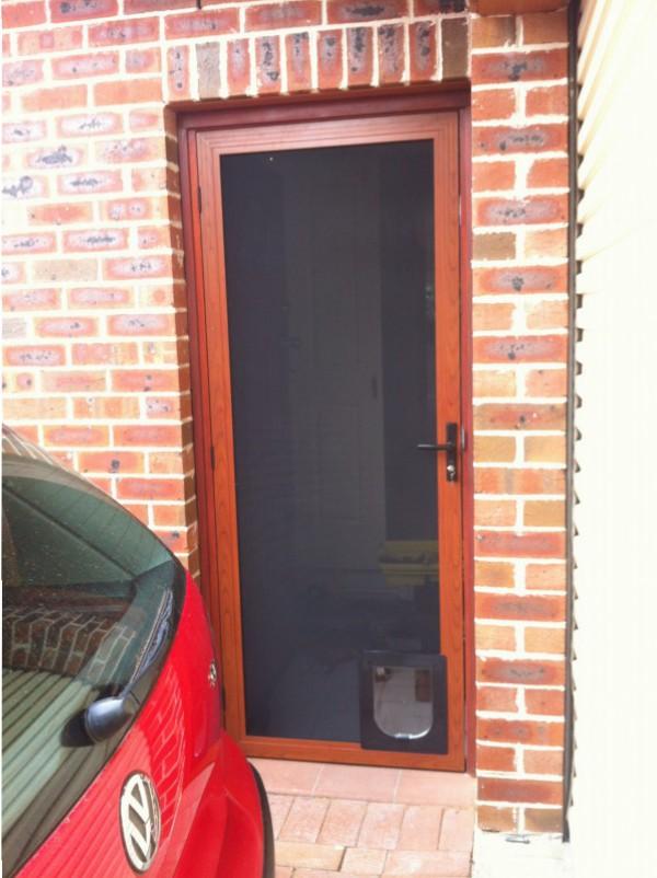 Stainless Screen Door With Pet Door Western Red Cedar Color. «